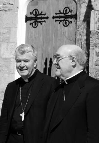 Bishop McGrattan and Bishop De Angelis in front of St. Peter's Cathedral.
